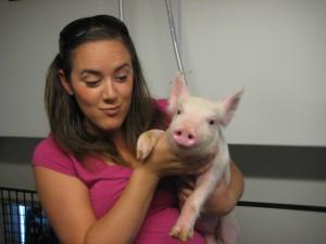 Cassie holding a Nursery Pig